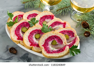 Sandwich with herring fillet, onion, pickled cucumber, cream cheese and beetroot. Holiday appetizer