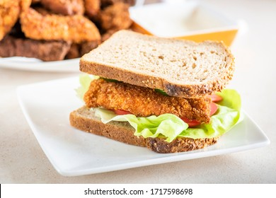 sandwich with homemade chicken strips coated in corn and garlic sauce