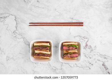 sandwich katsu sando with beef steak. wagyu katsu. japanese cuisine traditional food. Trendy healthy fast food at marble background