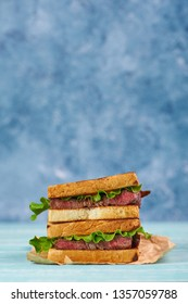 sandwich katsu sando with beef steak. wagyu katsu. japanese cuisine traditional food. Trendy healthy fast food snack. vertical
