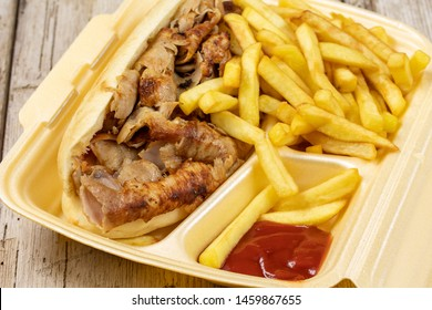 sandwich kebab and fries in a box