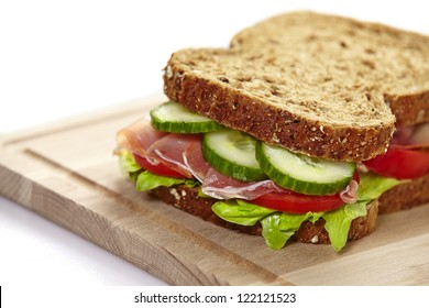 Sandwich with lettuce, bacon, tomato and cucumber