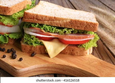 Sandwich with Lettuce, Tomato, bacon and Onion