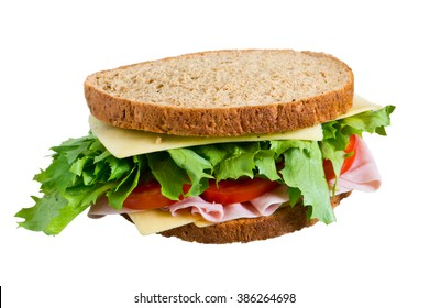 Sandwich with lettuce, tomato, ham and cheese  isolated on white