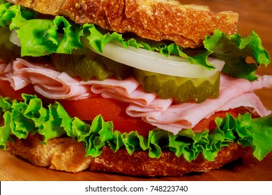 Sandwich with lettuce, tomato, ham and cheese sandwich with ham and tomatoes