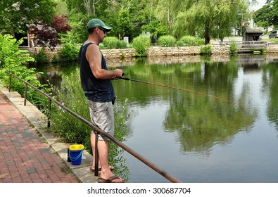 Sandwich, Massachusetts - July 15, 2015:  Local resident fishing in the mill pond by the Dexter Grist Mill on a quiet Summer afternoon
