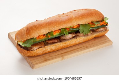 Sandwich with meat salad and cheese on a wooden board