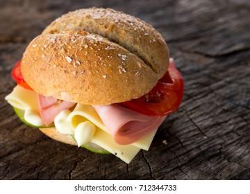 Sandwich with mortadella, cheese and vegetables