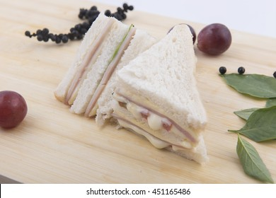 sandwich on a rustic table in bright light.