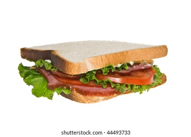 Sandwich on toasted bread isolated on white.