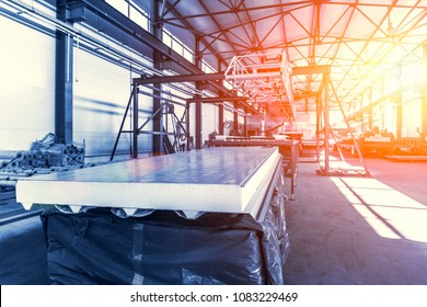 Sandwich panel or metal work profiling factory. New modern machine tool conveyor for roll forming, blue toned with sunlight effect