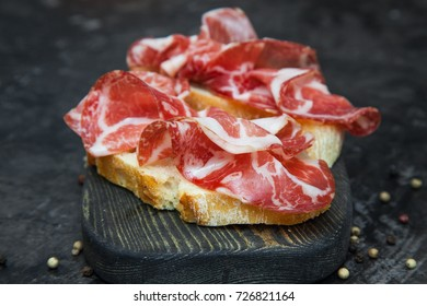 A sandwich with Parma ham. Ciabatta.