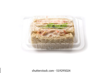 Sandwich in plastic package on white background