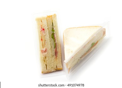 Sandwich in plastic package white background