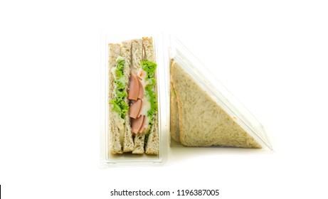 Sandwich in plastic packaging on white background