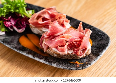 Sandwich with prosciutto, cheese and lettuce