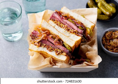 Sandwich with roast beef in wooden box. Close up.
