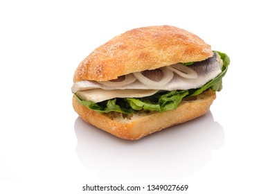 Sandwich roll with bismarck herring fisch and onion rings white isolated