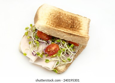 Sandwich with salad and baked ham on white background