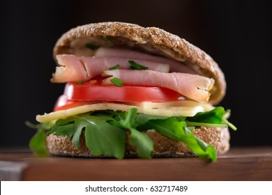sandwich with salad, ham, yellow cheese and tomato
