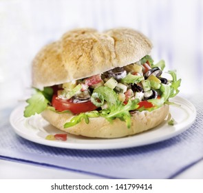 sandwich with salad served on a plate