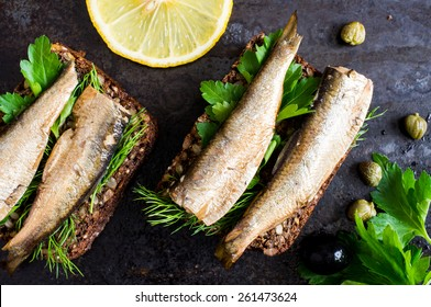 Sandwich with sardines, sprats with parsley and dill