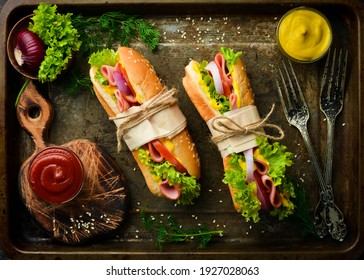 Sandwich with sausage, cheese and lettuce. Street food. Top view. Free copy space.