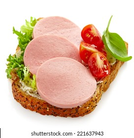 sandwich with sliced sausage isolated on a white background