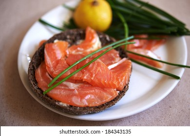 sandwich with smoked salmon and chives. shallow dof