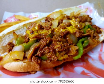 Sandwich with steak - chicken, cheese and lettuce with liquid cheese