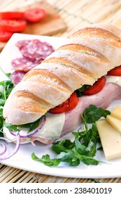 Sandwich with tomato, cheese, and ham