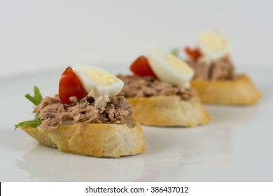 Sandwich with tomato, tuna and egg isolated on white, selective focus