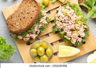Sandwich with tuna, olives and lemon. Delicious lunch, healthy food, snack with fish on crispy toast