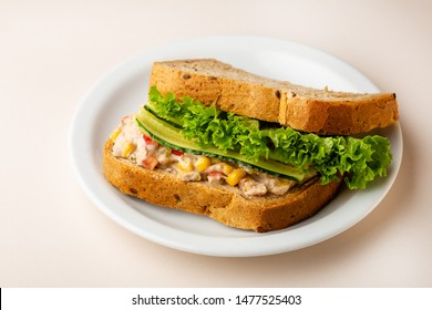 Sandwich with tuna and vegetables on plate