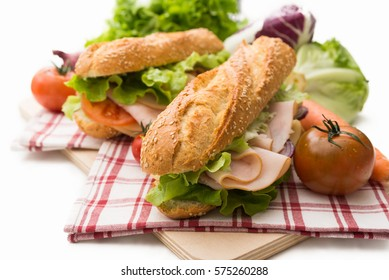 Sandwich with turkey roast, cheese and vegetables