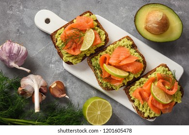 Sandwiches with avocado spread and smoked salmon.