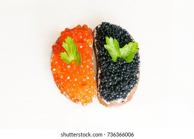 sandwiches with black caviar and red caviar, isolated on white background
