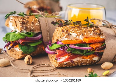 Sandwiches with ham, cottage cheese, vegetables and herbs. Close-up.