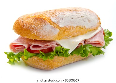 sandwiches with ham and vegetables on white background