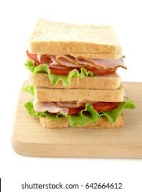 Sandwiches with lettuce,tomato,cold cuts on white background on cutting board