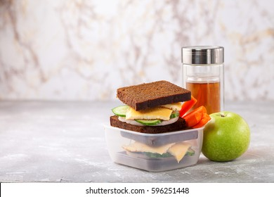Sandwiches in a lunchbox on a table. Selective focus. Copy space