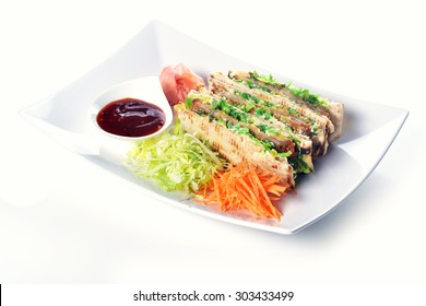 sandwiches with meat and vegetables on  plate