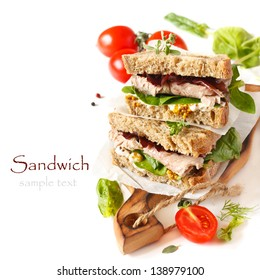 Sandwiches with meet, vegetables and mustard on crusty fresh sliced rye bread.