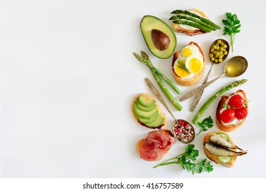 Sandwiches on a light background, or assorted canapes, top view