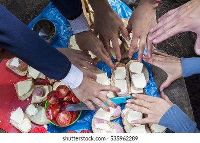 sandwiches outdoors, hungry people