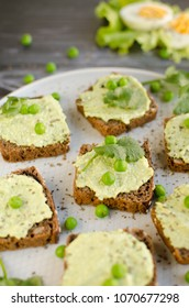 Sandwiches with pea pate on a plate