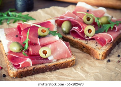 sandwiches with prosciutto,  vegetables and spices