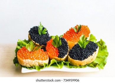 Sandwiches with red and black caviar
