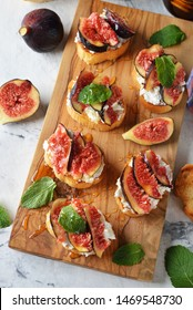 Sandwiches with ricotta cheese, honey and figs on a white background