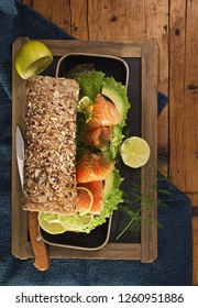 Sandwiches rye cereals bread with avocado  and salmon on a wooden table   . Health snacks concept. Top view. Copy space.